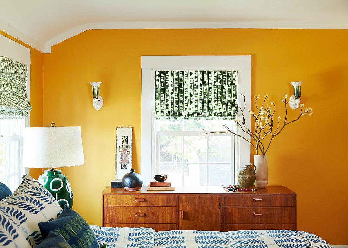 Captivating-yellow-accent-wall-coupled-with-green-blinds-and-blue-bedding-in-the-eclctic-bedroom-98219