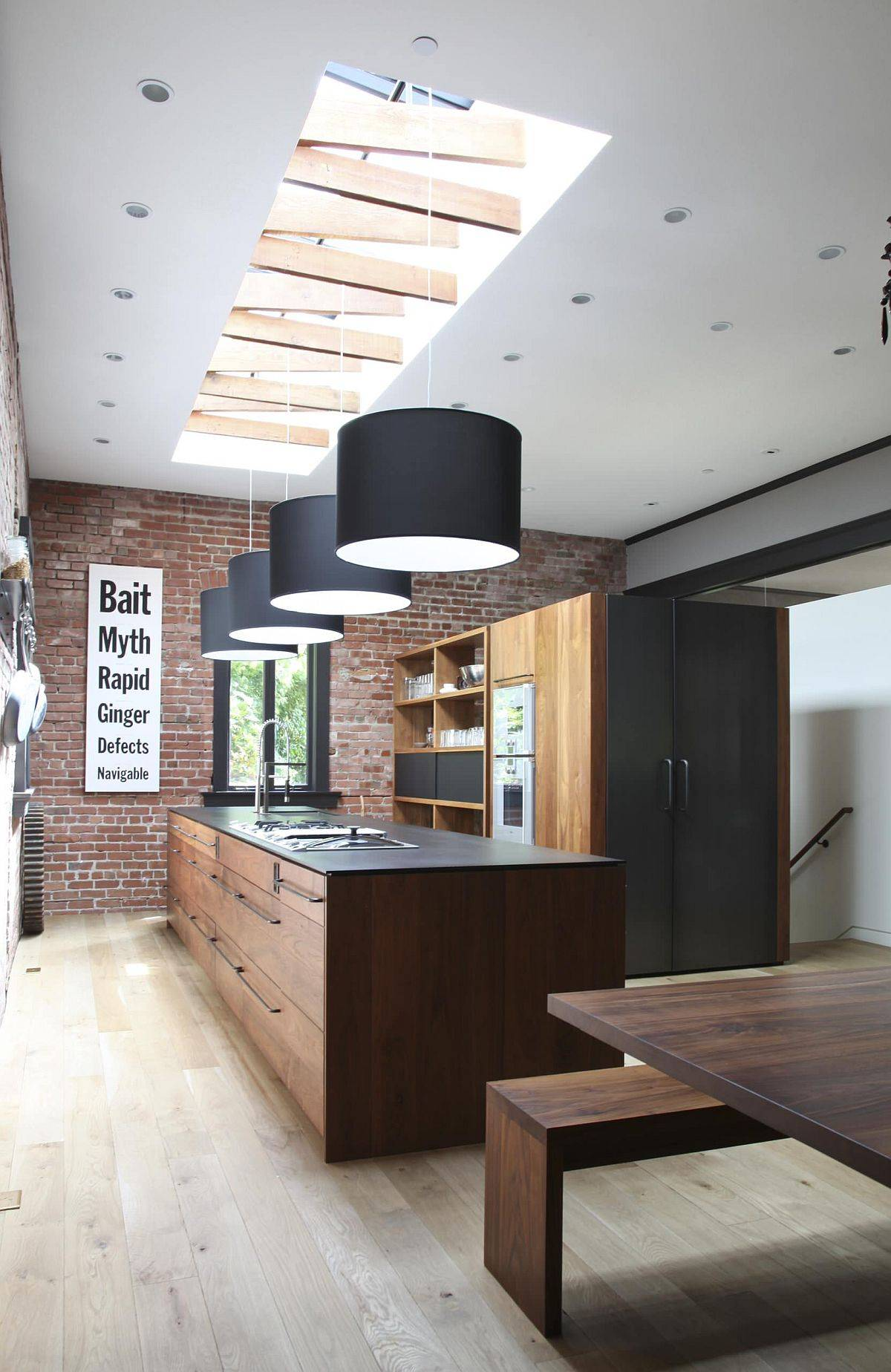 Combing-natural-light-with-artifcial-lighting-fixtures-usind-skylight-and-drum-pendants-91445