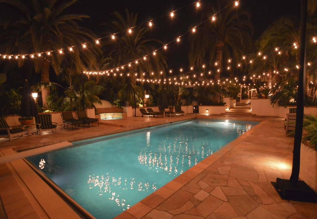 pool at night with string lights