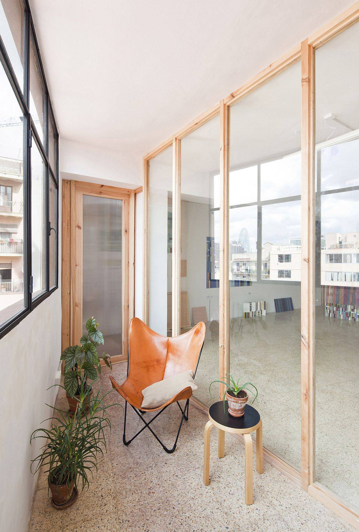 Creative-use-of-wooden-frames-and-glass-walls-brings-new-spatial-configuration-to-this-Barcelona-home-27377