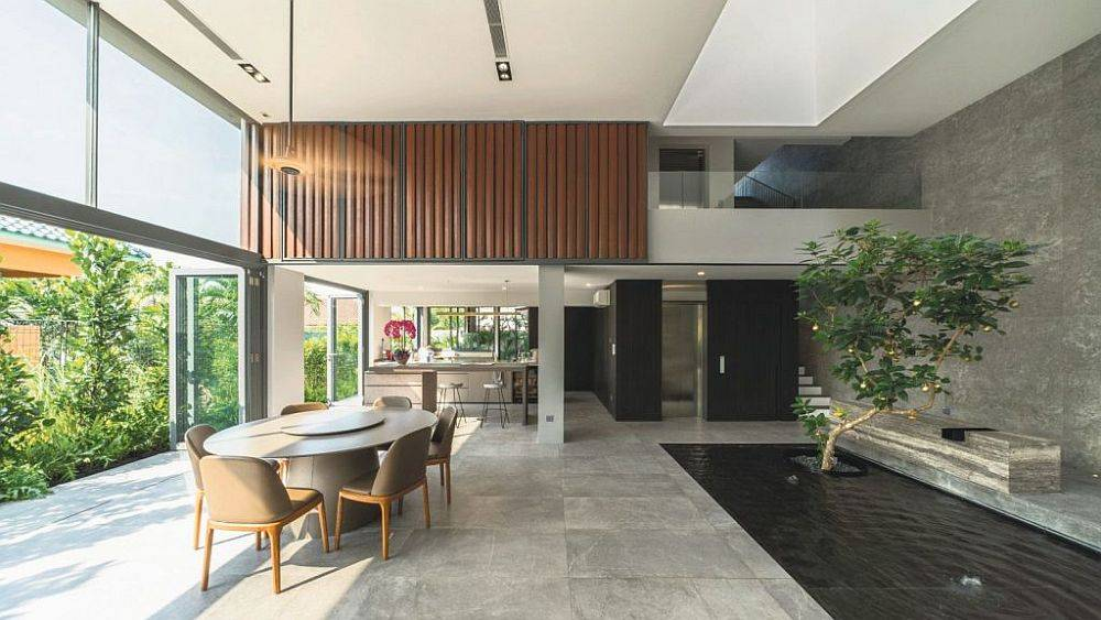 Cross-ventilation, indoor water feature and passive solar design keep this home cool at all times