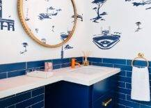 Custom-blue-cabinet-tiles-and-a-wallpaper-with-midcentury-vibe-grace-this-eclectic-powder-room-96452-217x155