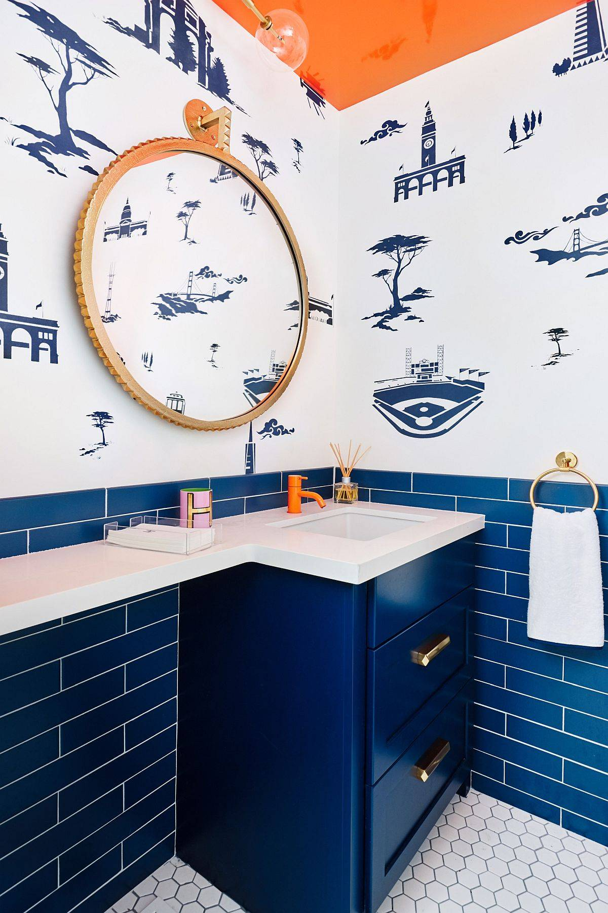 Custom-blue-cabinet-tiles-and-a-wallpaper-with-midcentury-vibe-grace-this-eclectic-powder-room-96452