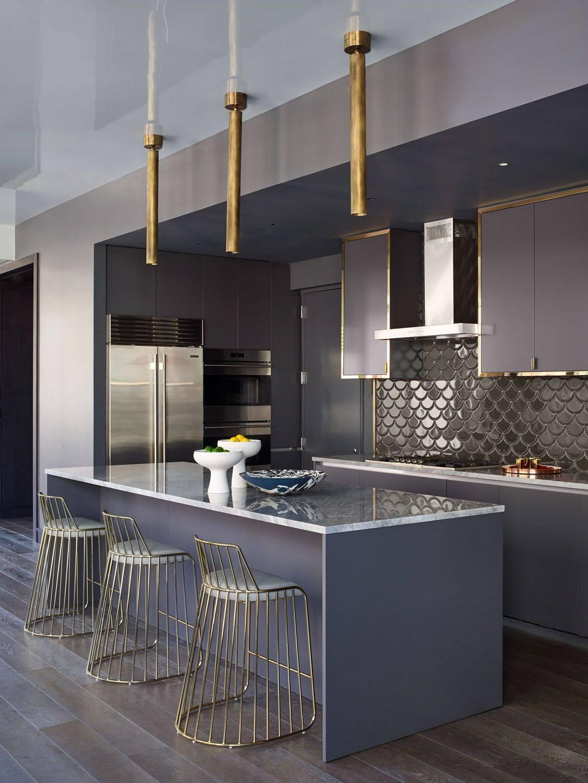 Dark and Gold Themed Kitchen with Dark Backsplash