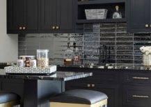 Dark and Gold Themed Kitchen with Dark Backsplash.