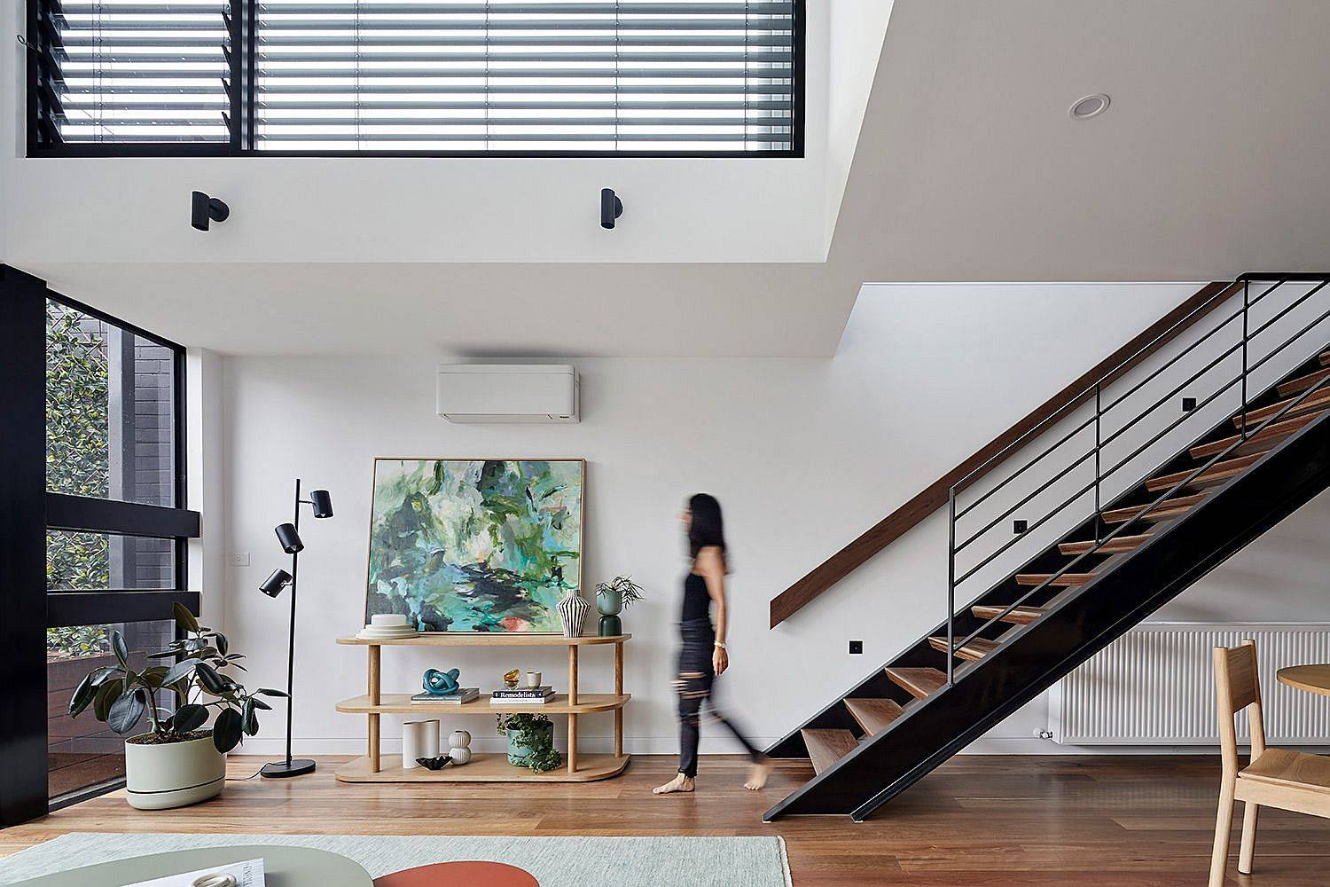 Double-height-living-area-in-the-rear-with-operable-windows-brings-in-ample-natural-light-64233