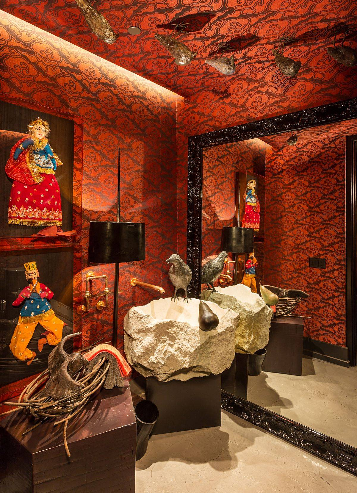 Eye-catching-orange-wallapaper-custom-stone-sink-and-puppet-artwork-with-Indian-theme-shape-a-truly-unique-eclectic-powder-room-28859