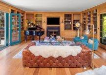 Family-room-of-the-home-in-wood-with-a-pluh-leather-couch-and-a-cozy-fireplace-94828-217x155