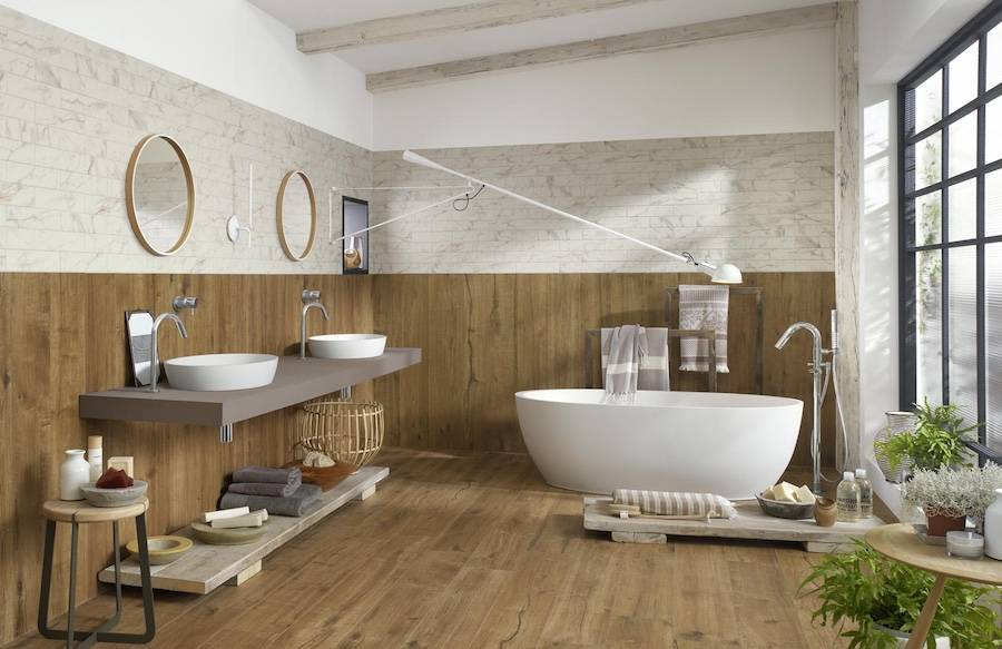 Full Wood Tile Bathroom With White Bathtub.
