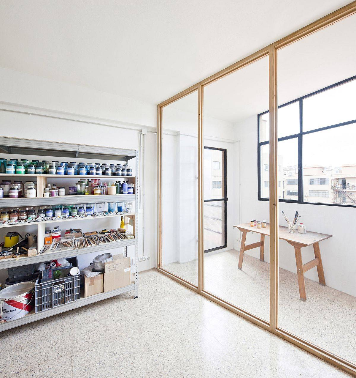 Glass-doors-with-wooden-frame-create-a-room-within-a-room-inside-this-Barcelona-Studio-88039