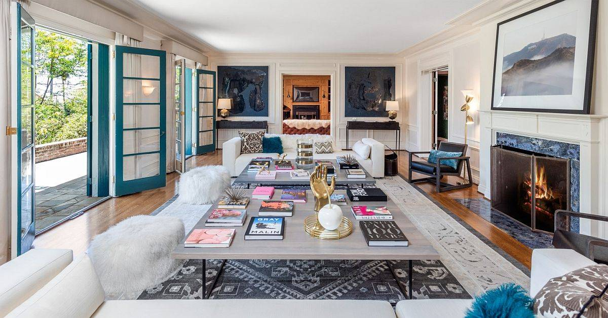 Glass framed doors in teal add color to the different rooms in white of the luxurious star home