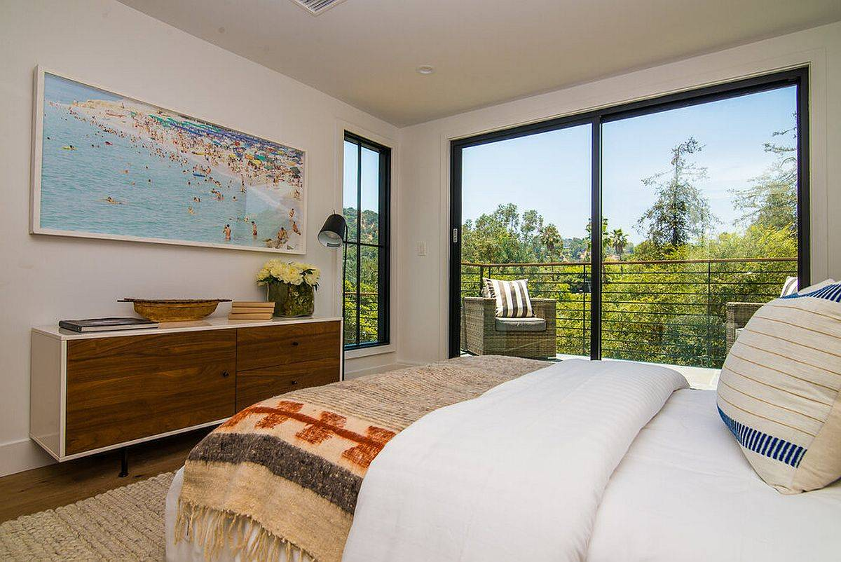 Gorgeous master bedroom with a view of Hollywood Hills in the distance and greenery all around