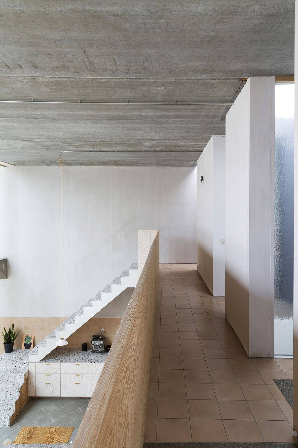 Interior-of-the-adaptive-home-clad-in-concrete-wood-and-mosaic-36966