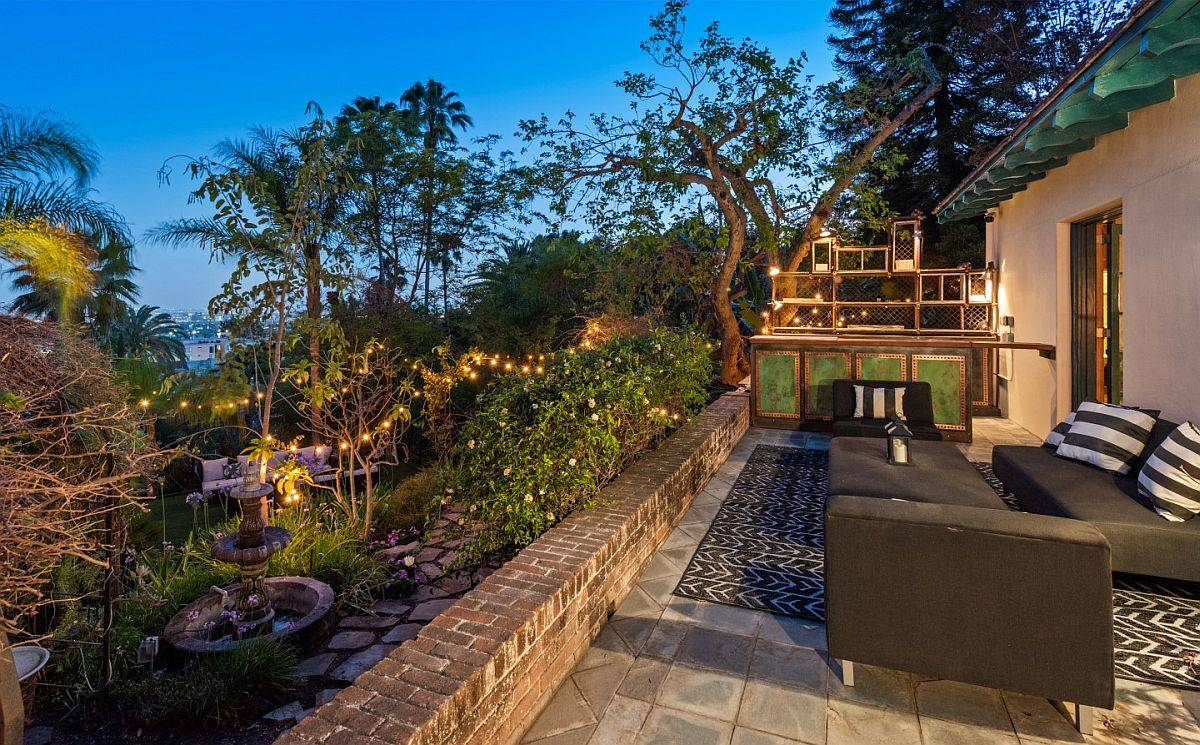 Lovely patio of the luxurious mansion with comfy seating space and amazing views