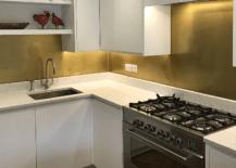 Modern Kitchen with White Cabinet and Brass Backsplash