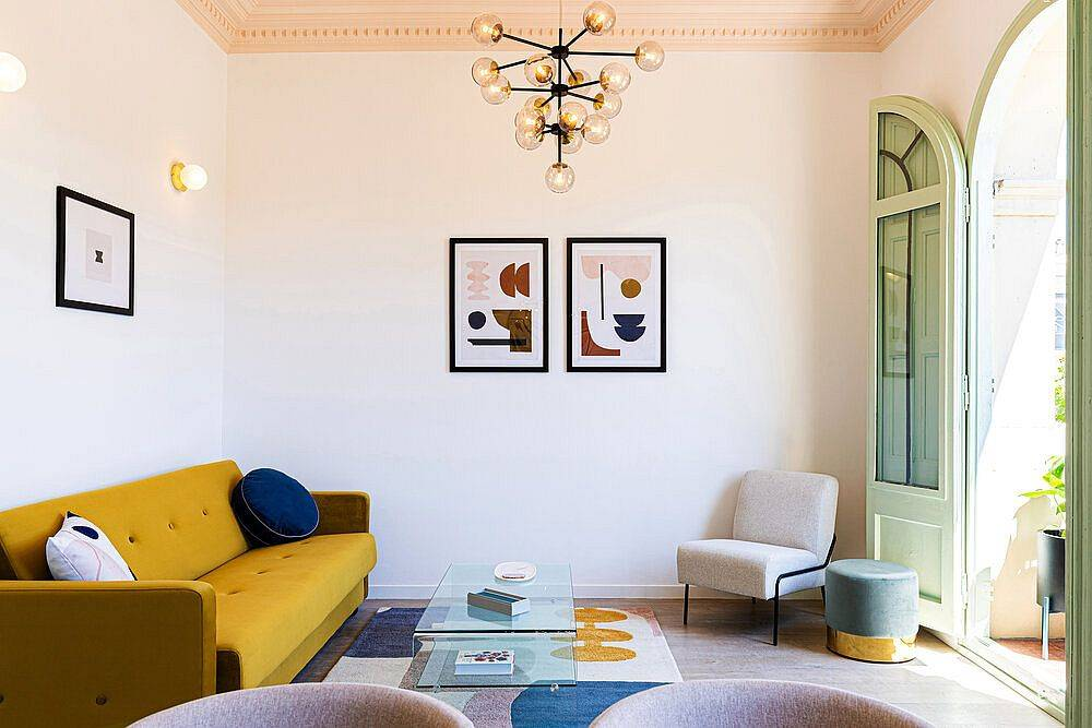 Modern-art-and-bright-yellow-couch-steal-the-show-in-this-small-living-room-78884