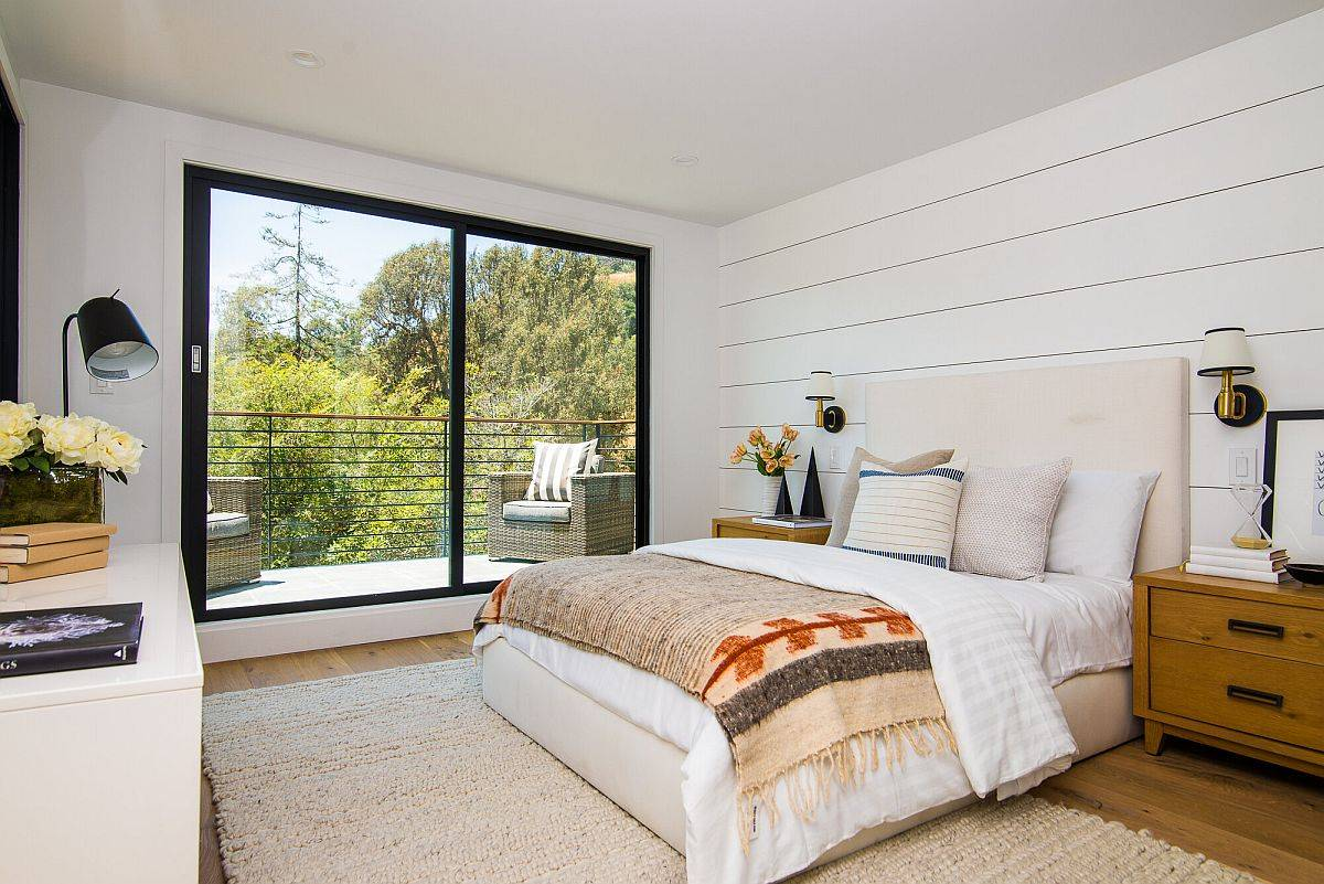 Modern beach style bedroom in white with cozy textiles and ample natural light