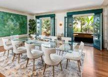 Modern-dining-room-with-glass-dining-table-green-wall-art-piece-and-blue-shutters-76585-217x155