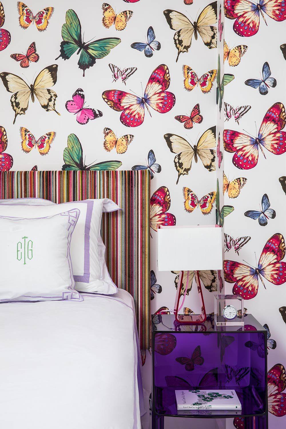 Multi-colored-butterflies-enliven-this-tiny-bedroom-in-white-58393