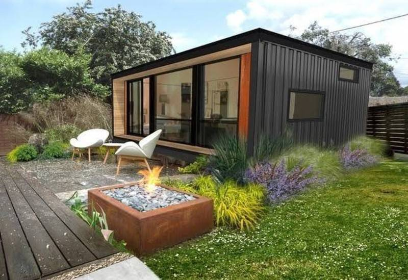 container home with lounge chairs and firepit