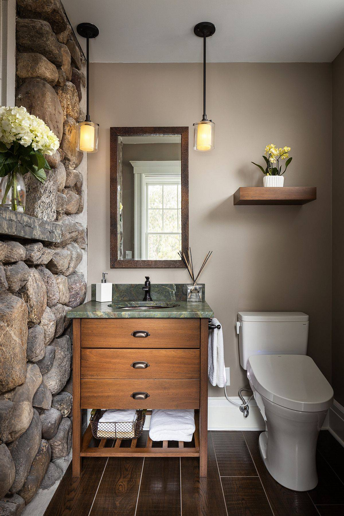 Rustic-powder-room-inspired-by-the-classic-cabin-style-in-New-York-with-a-stone-wall-10787