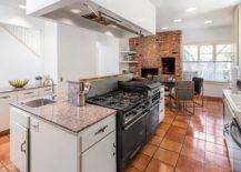 Saltillo-tile-kitchen-with-a-brick-wall-and-fireplace-at-the-other-end-and-cabinets-in-white-28488-217x155