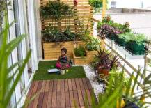 faux grass on balcony with plants and colorful accents