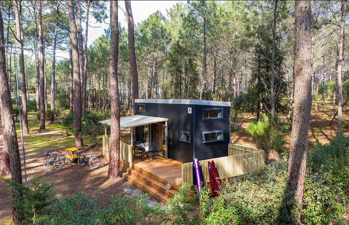 Small-and-space-savvy-wooden-cabin-in-the-forest-with-custom-nets-that-offer-additional-sleeping-areas-70991