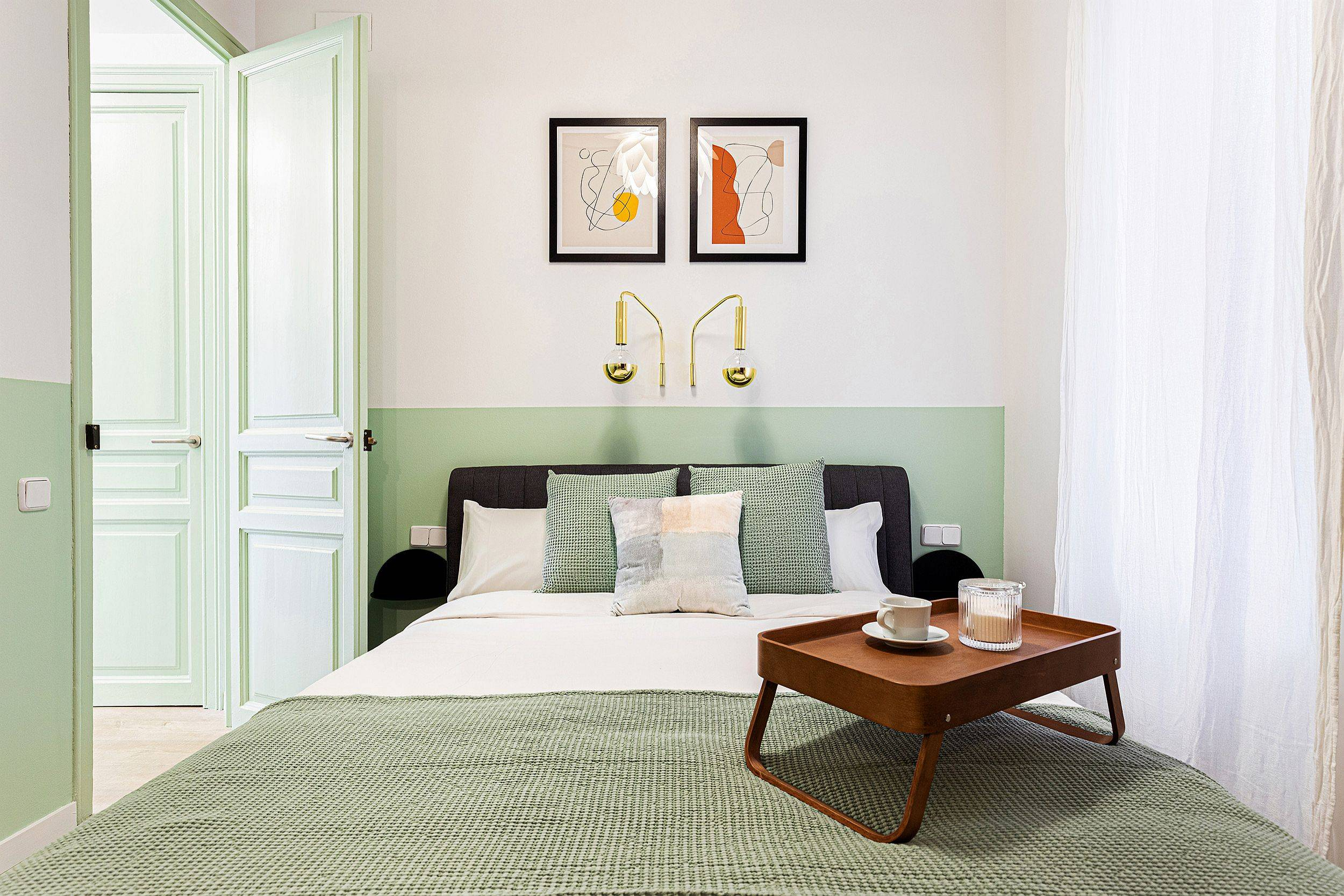 Small-and-stylish-modern-bedroom-in-white-and-pastel-green-is-perfect-for-the-vacation-apartment-23437