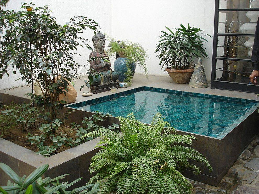 Small courtyard with greenery and a lovely water feature cools your home down on a hot summer day