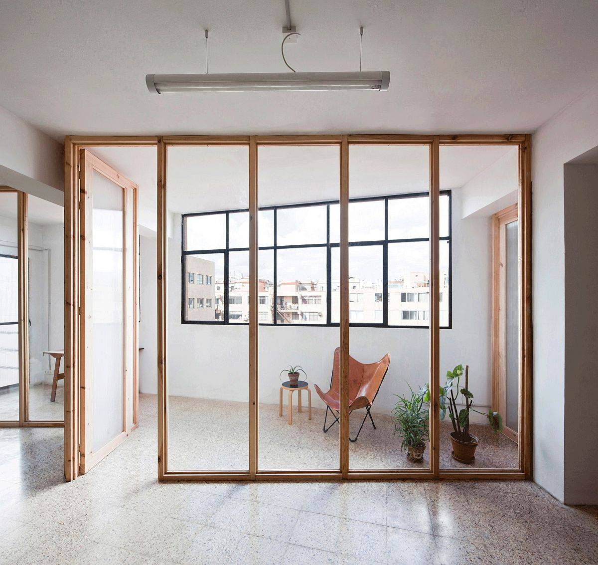 Space-between-the-window-walls-and-the-wooden-partitions-serves-as-the-covered-outdoor-area-89295