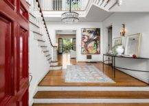 Spacious-and-stylish-foyer-of-the-home-in-white-with-a-bright-red-door-and-smart-lighting-86133-217x155