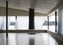 Stunning-minimal-concrete-interior-of-the-home-with-wooden-ceiling-and-a-fabulous-fireplace-59687-217x155