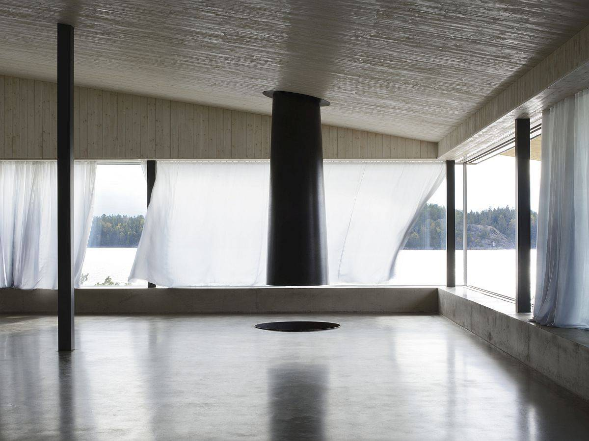 Stunning-minimal-concrete-interior-of-the-home-with-wooden-ceiling-and-a-fabulous-fireplace-59687