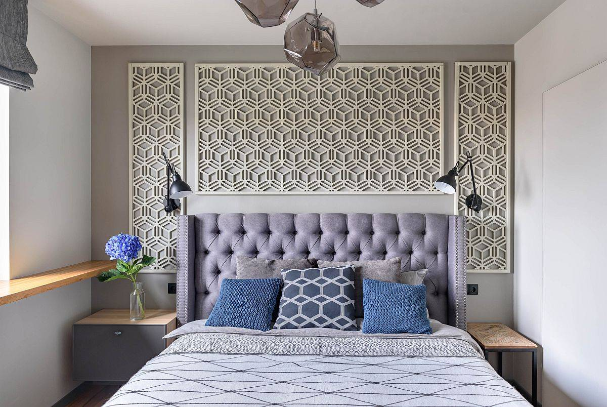 Wall-panels-with-overlapping-hexagon-motifs-make-an-impression-in-this-small-modern-bedroom-in-gray-and-white-23872