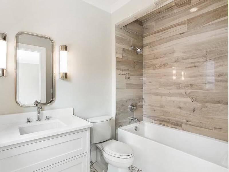 White Bathroom With Wood Tile Accent Wall