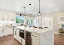 White Cabinets with Metallic Chandeliers.