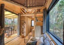 Window-ushers-the-outdoors-into-the-tiny-vacation-home-in-wood-20273-217x155