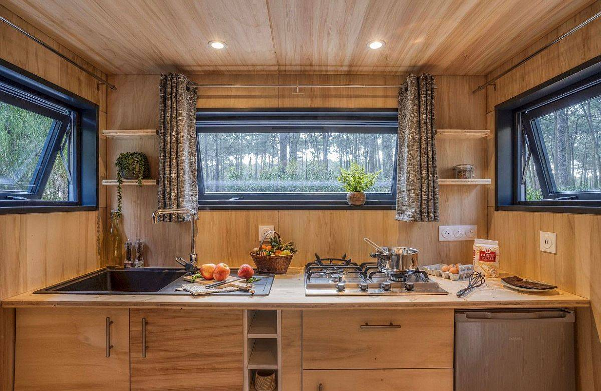 Windows-bring-the-outdoors-into-the-tiny-kitchen-in-wood-with-a-smart-workstation-30274