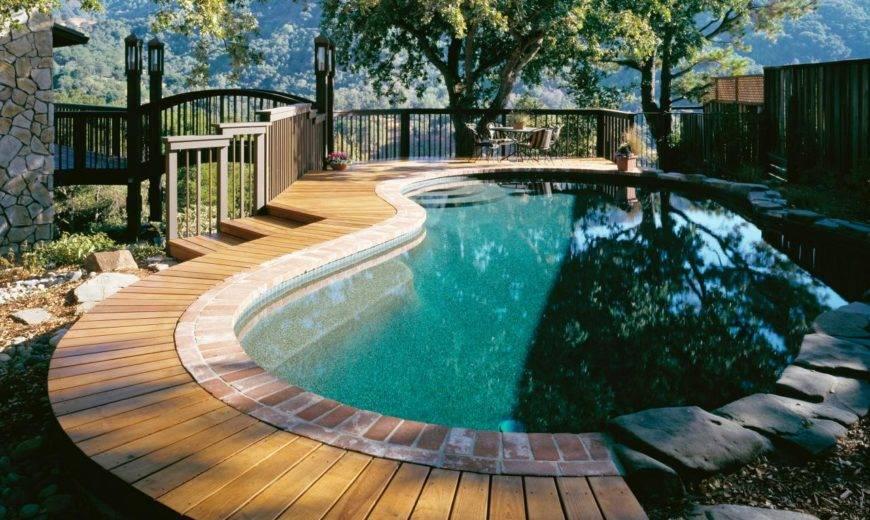 Make A Splash With These Stylish Wood Pool Deck Ideas