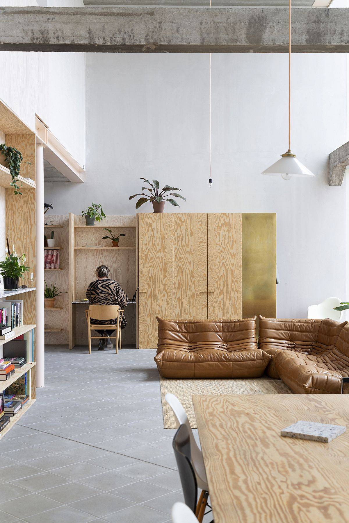 Wooden-decor-Togo-sofa-and-neutral-interior-of-the-modern-home-living-room-35700
