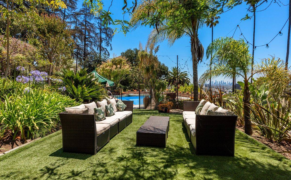 Yard with ample sitting space and lots of greenery all around