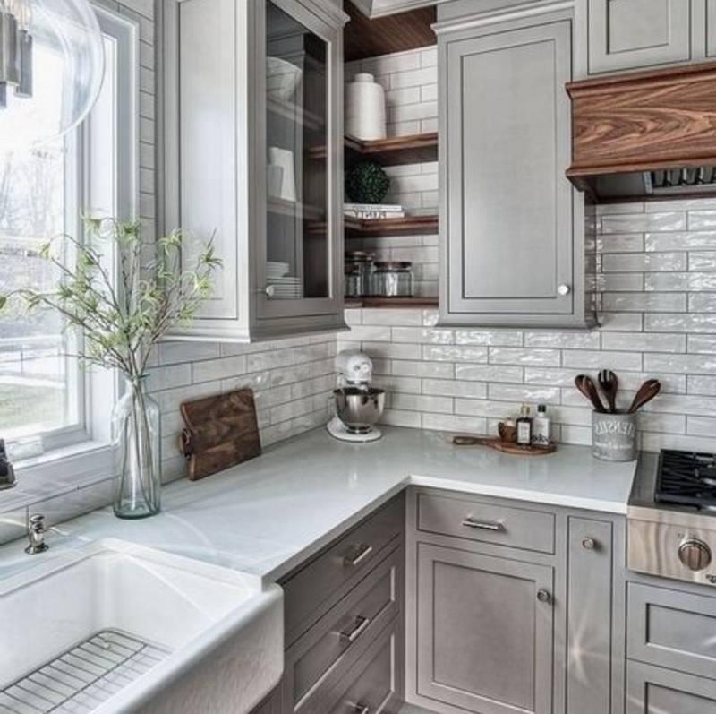 grey granite countertops against grey cabinets and white backsplash