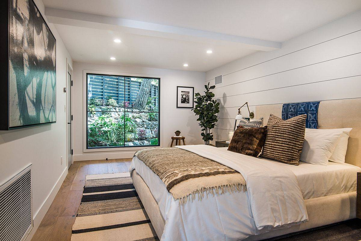 Bedroom below the ground level with garden outside the large window