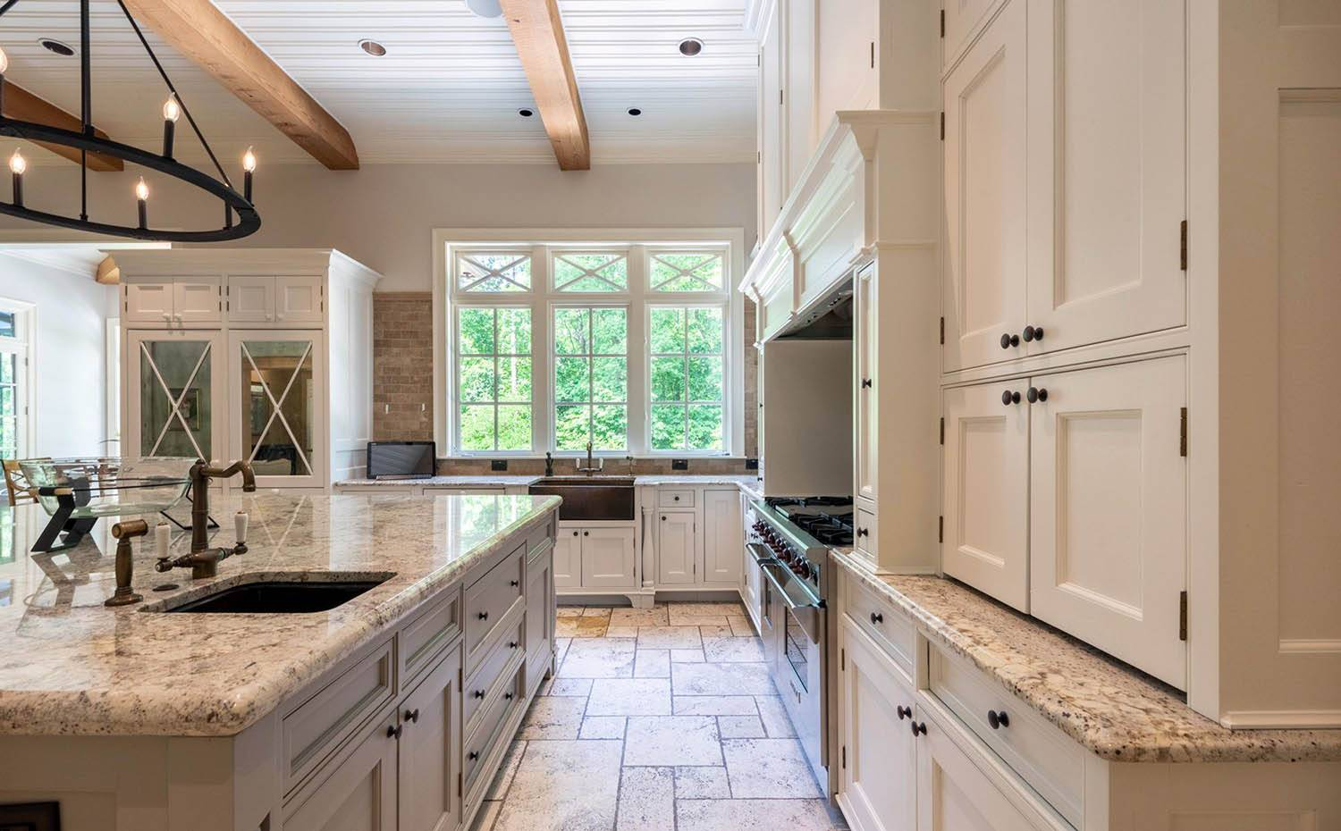 cream kitchen cabinets with light speckled granite countertops