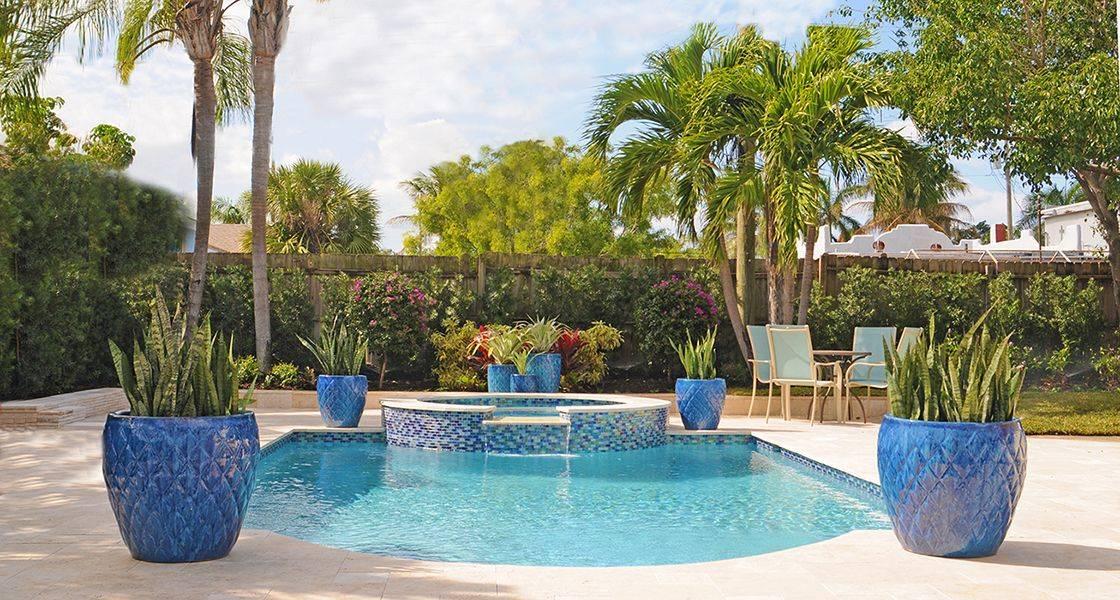 blue mosaic tile planters on pool patio