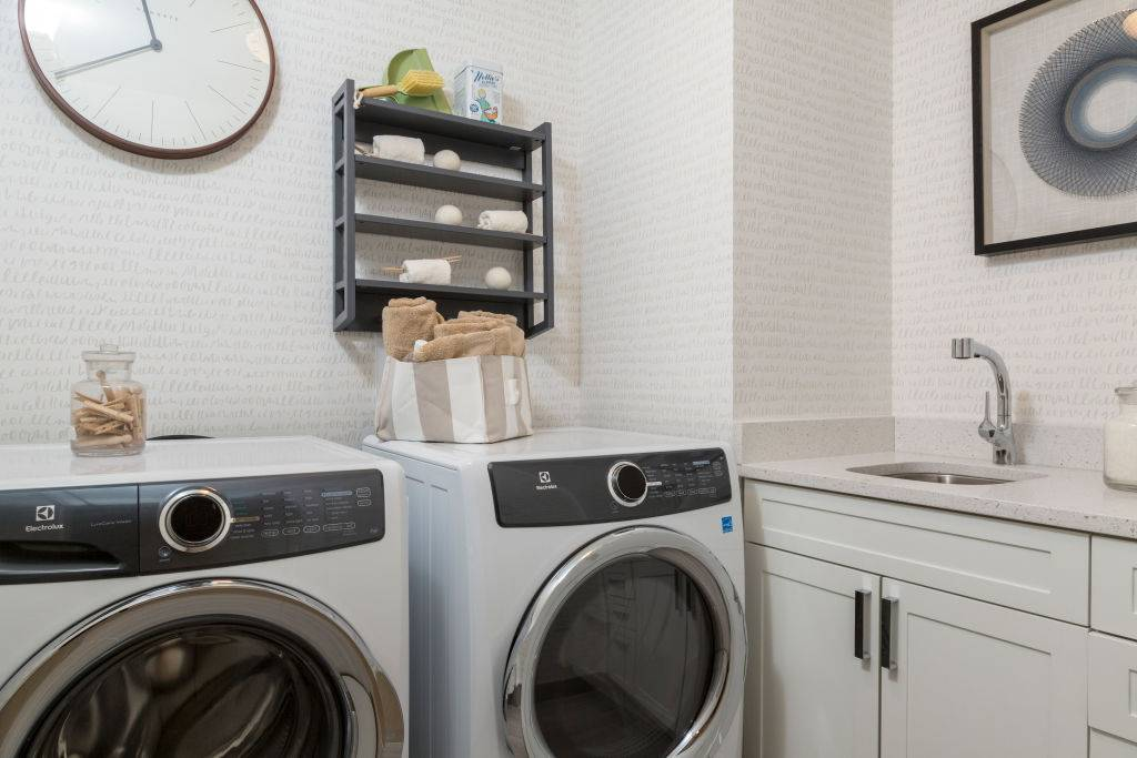 Laundry Room with Wall Art