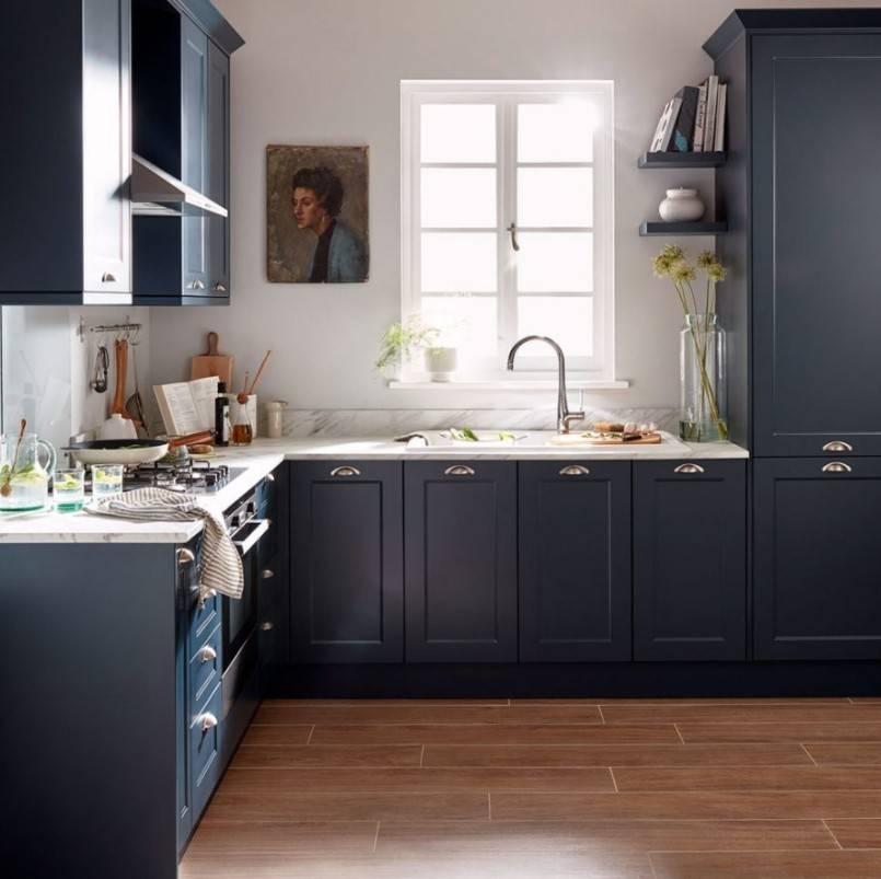 dark black/blue cabinets in kitchen