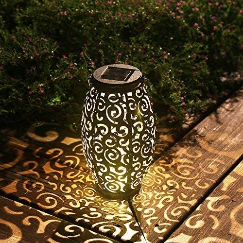 outdoor lantern with design that displays light patterns on ground