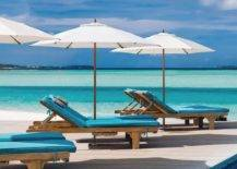 white patio umbrella on deck covering lounger